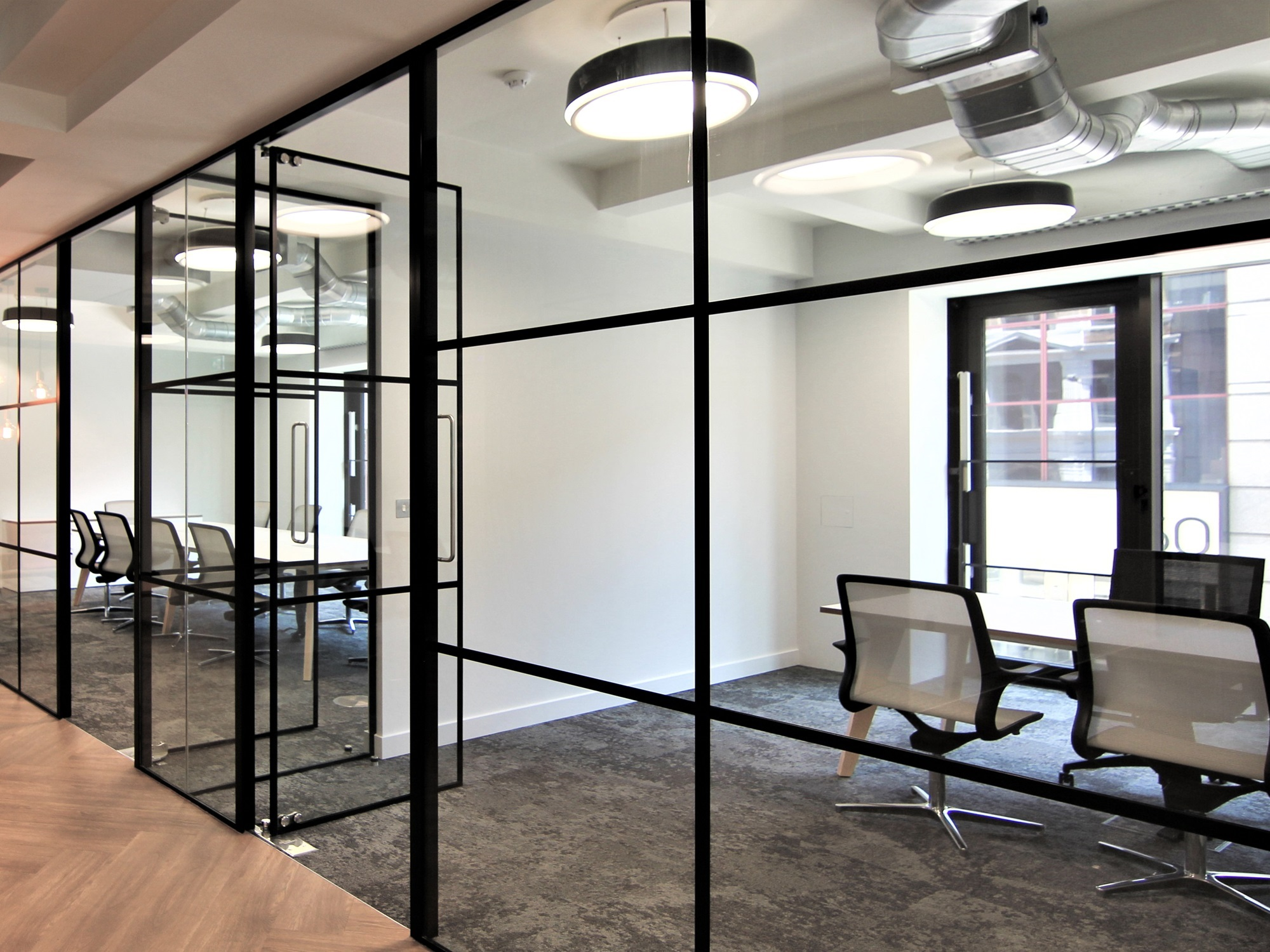 office space divided by glass walls