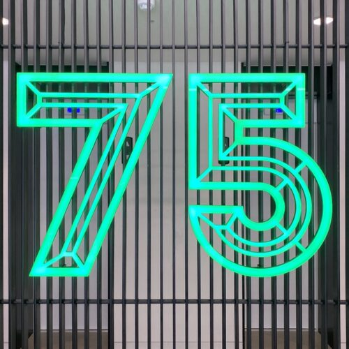 neon number 75 on the wall