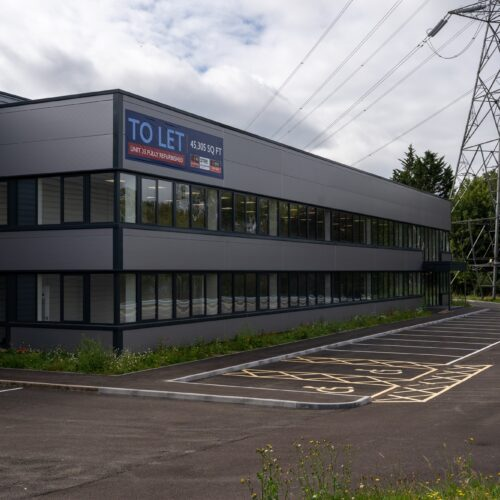 large warehouse unit building with Buy To Let sign