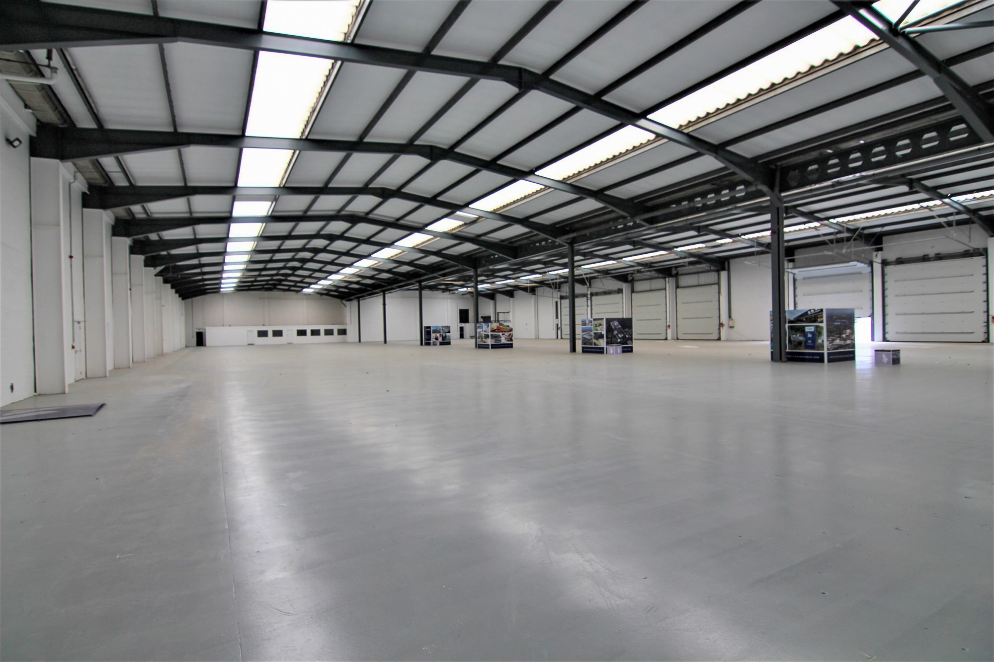 empty warehouse unit with ceiling lights