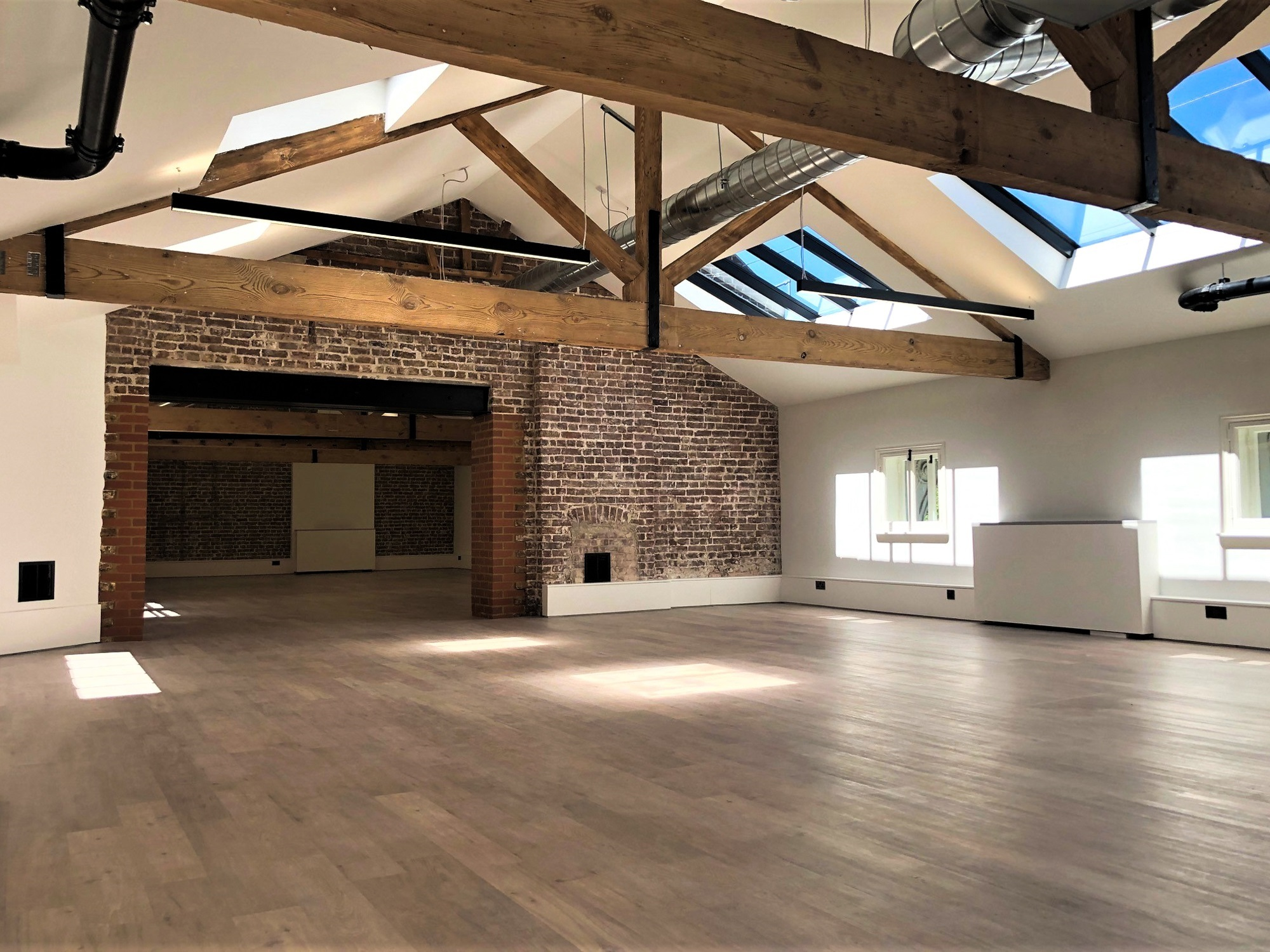 empty building with exposed wooden beams