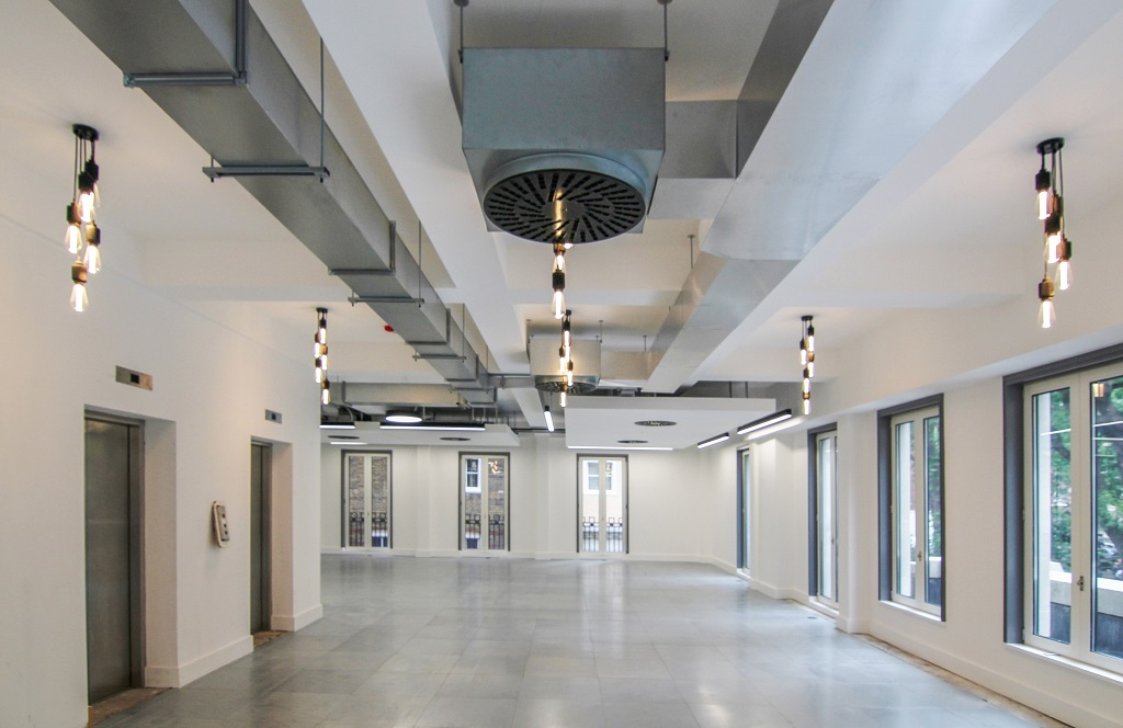 empty office floor with exposed air conditioning system and vents