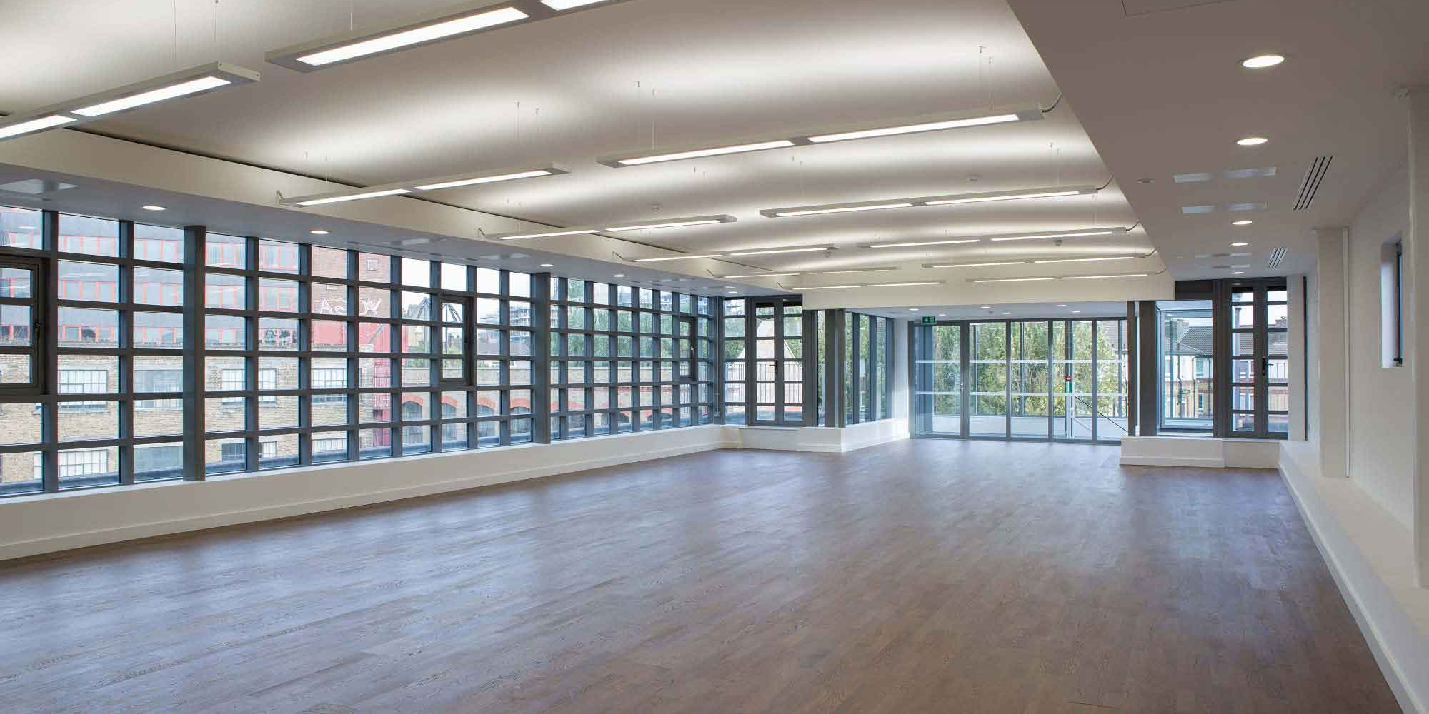 empty apartment with wooden floor and grid windows