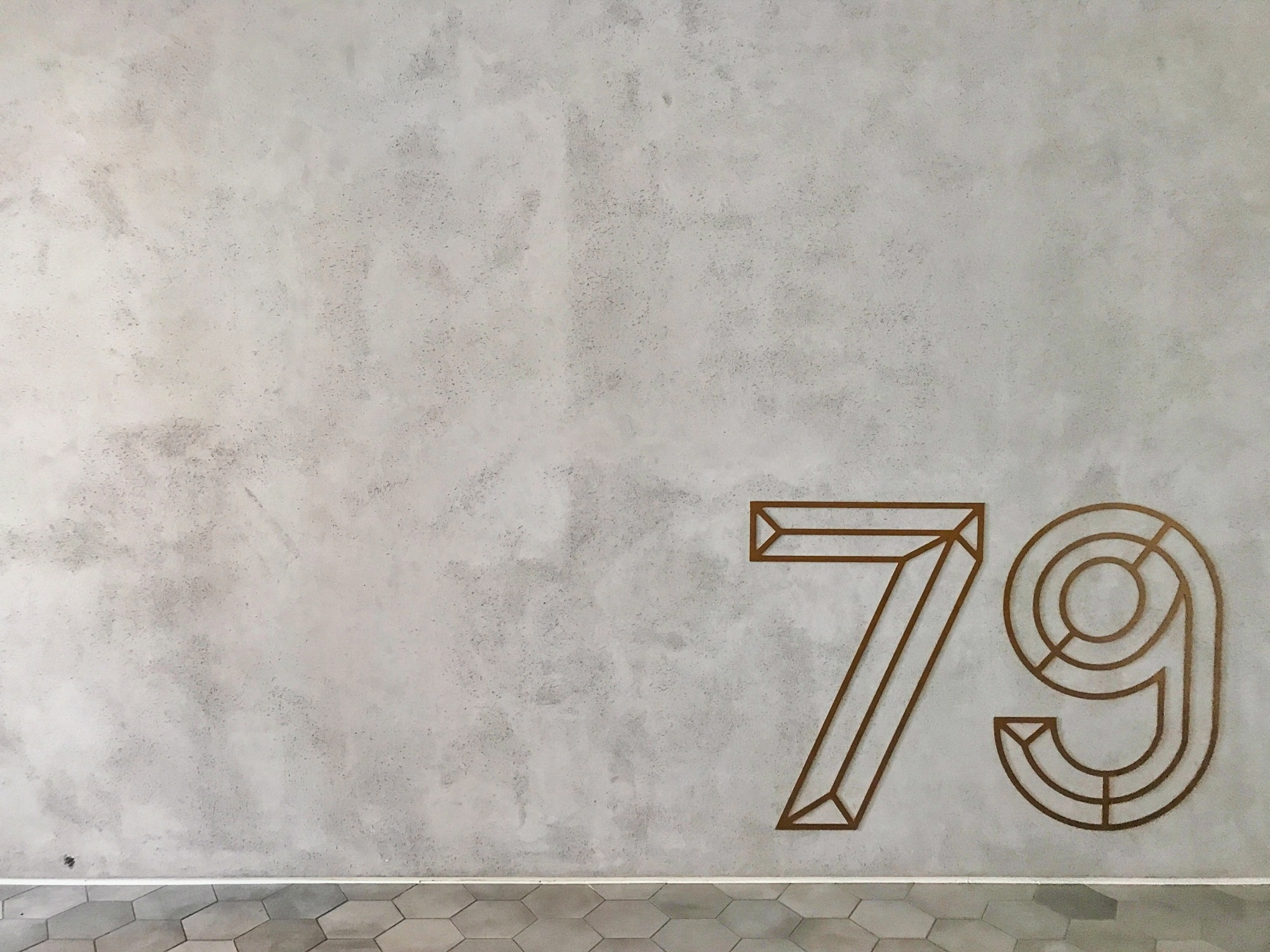 numbers engraved on concrete wall