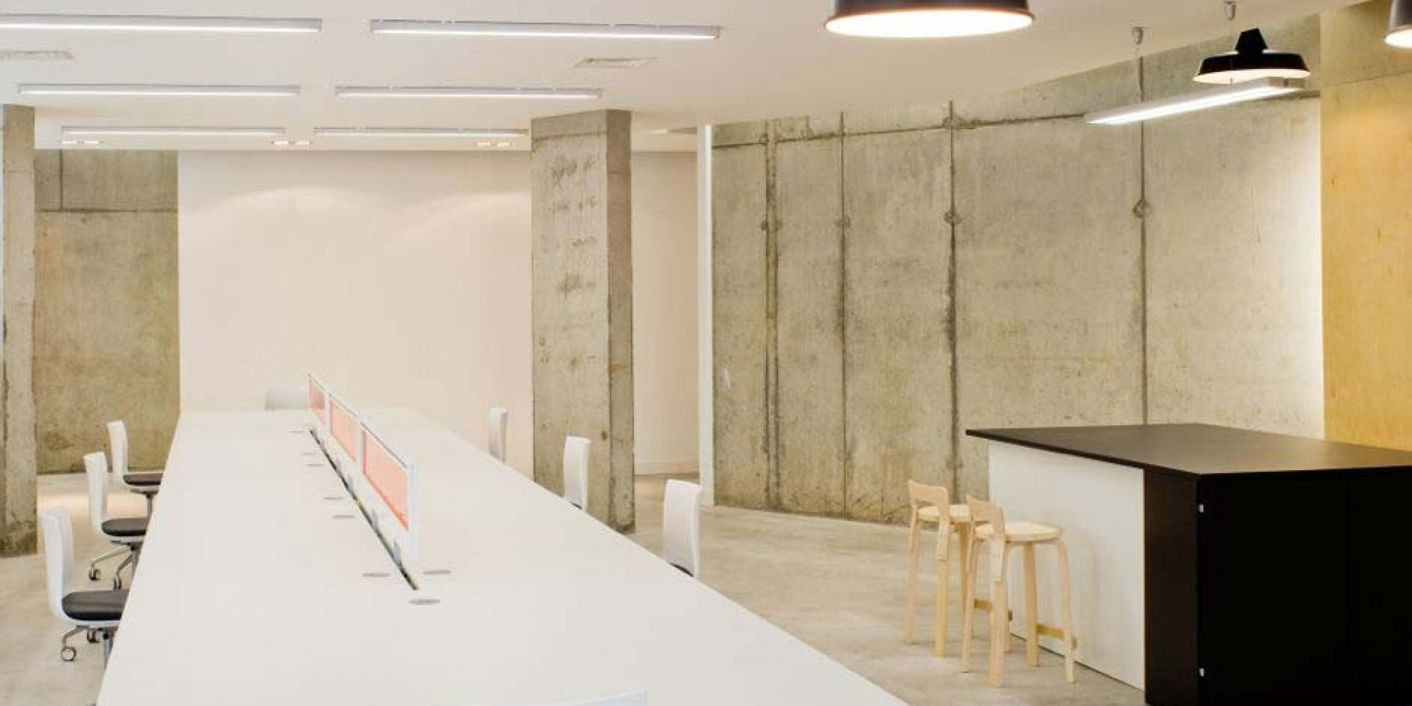 office with exposed concrete wall