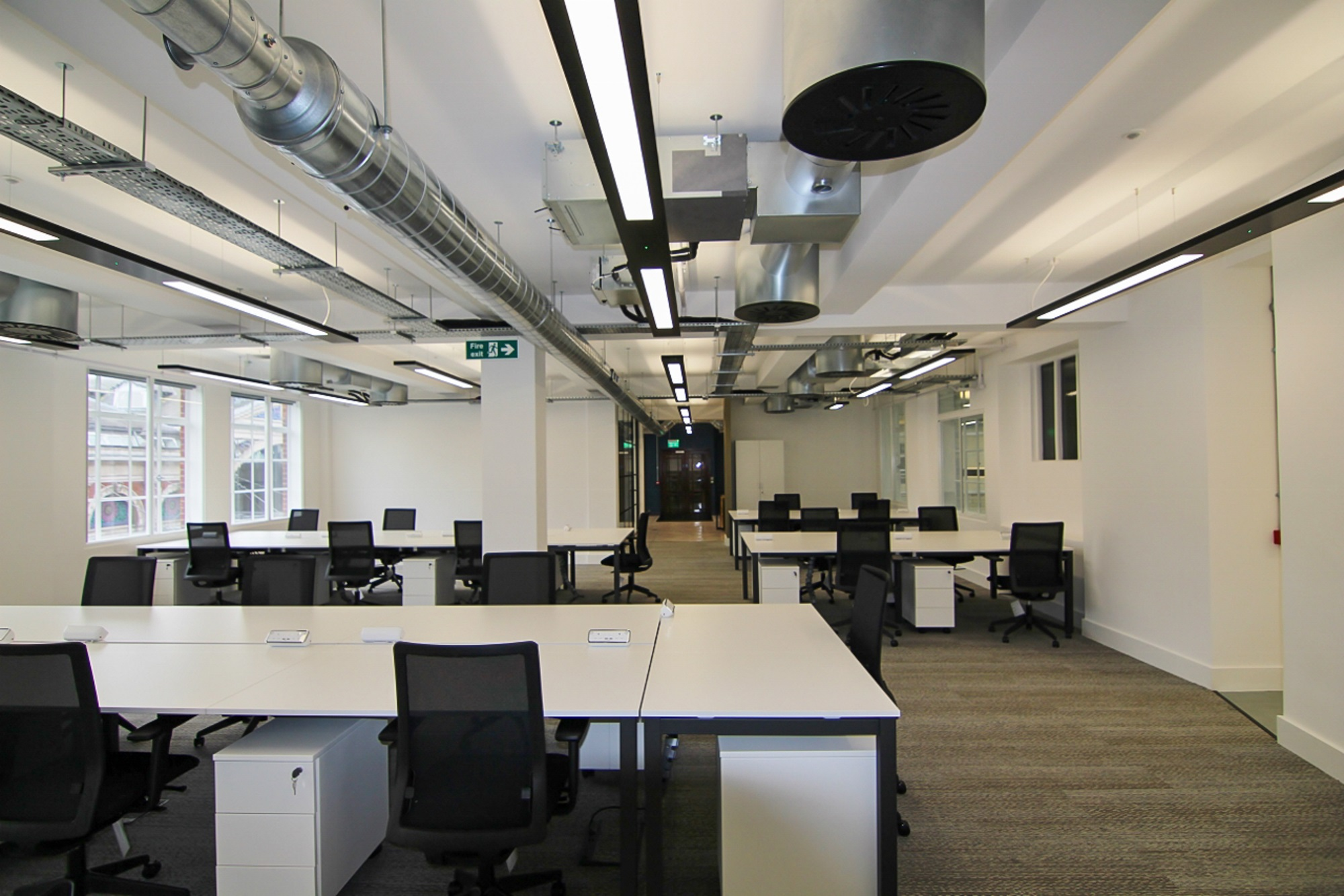 an empty office with an exposed ceiling