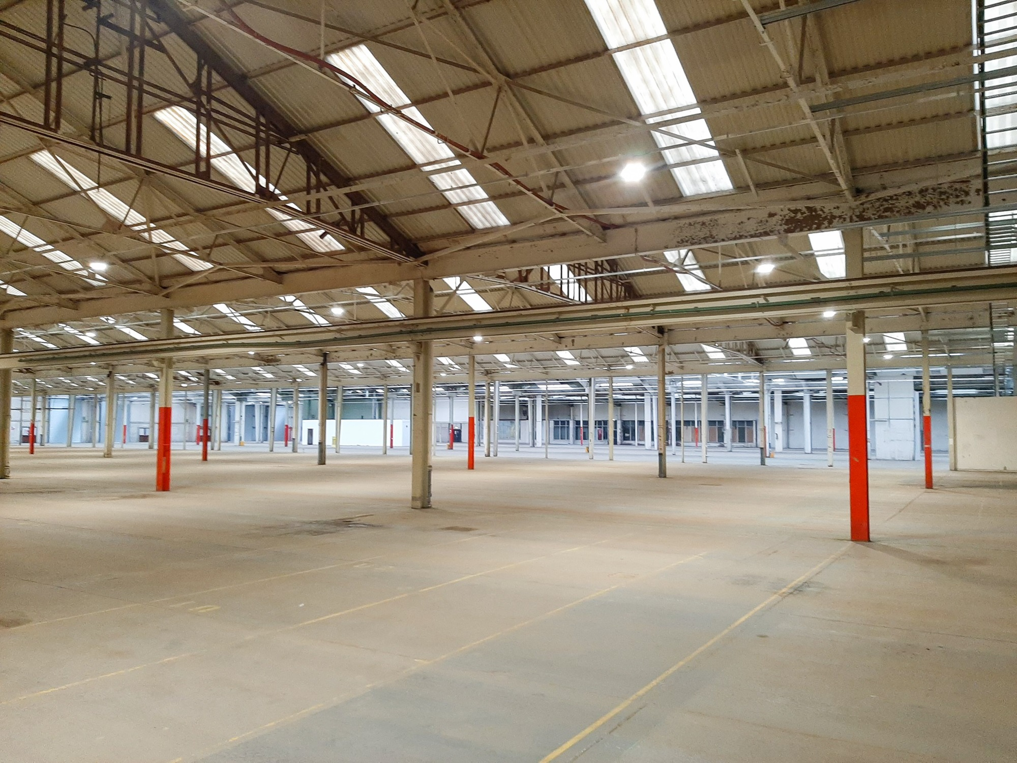 empty warehouse unit with metal columns