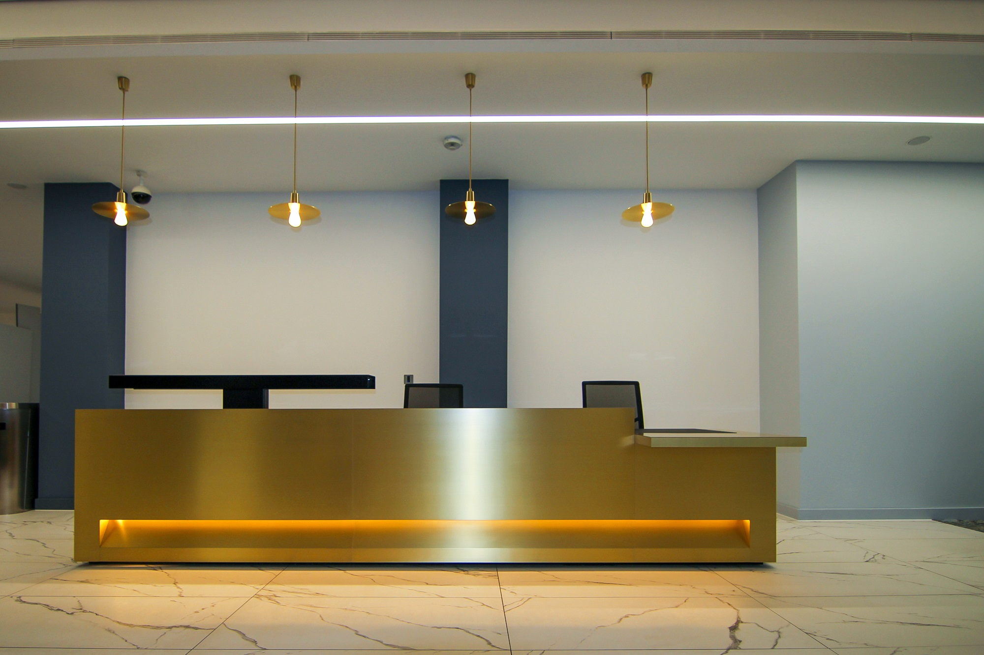 large brass and gold reception desk