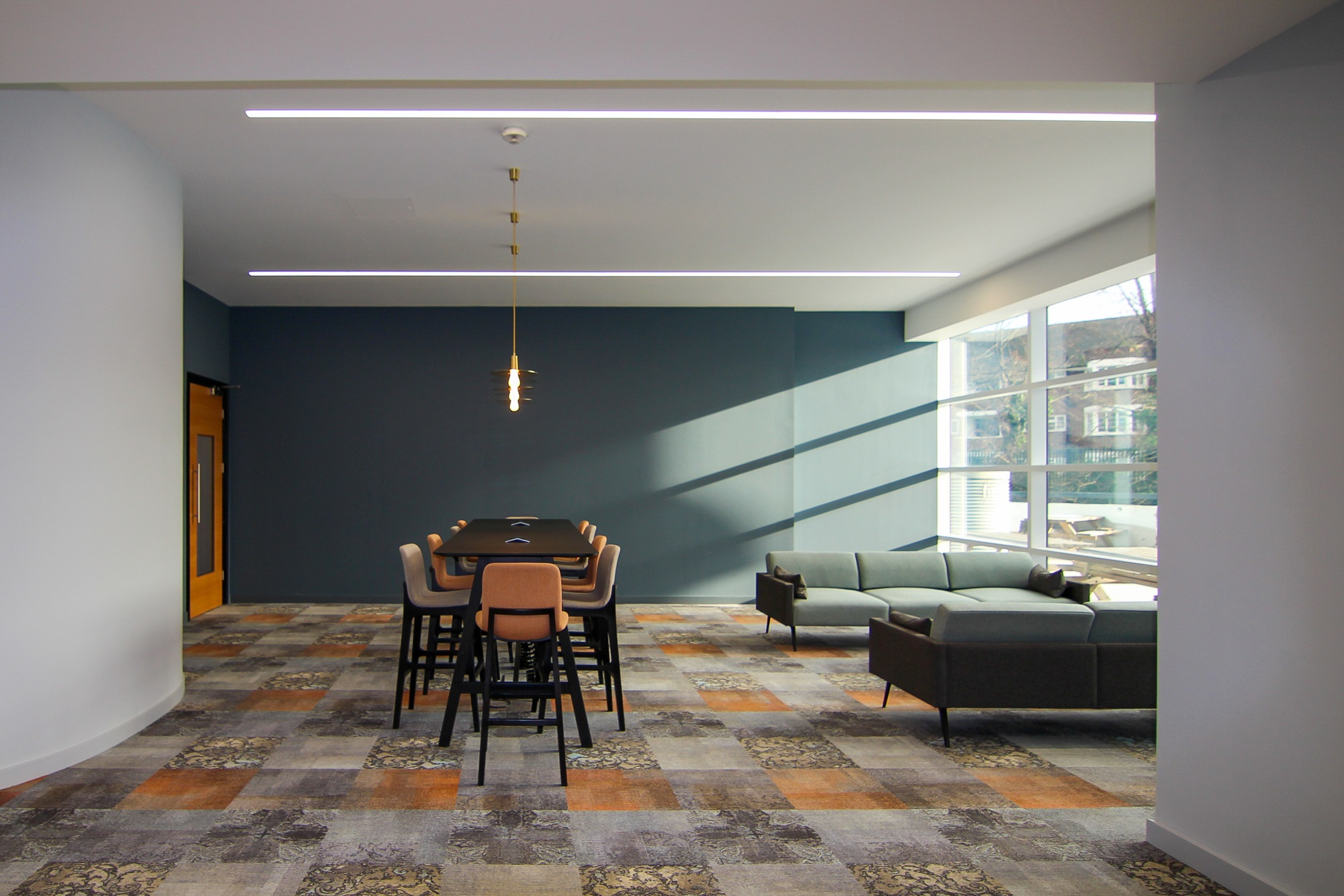 open room design with a glass wall, table and sofas