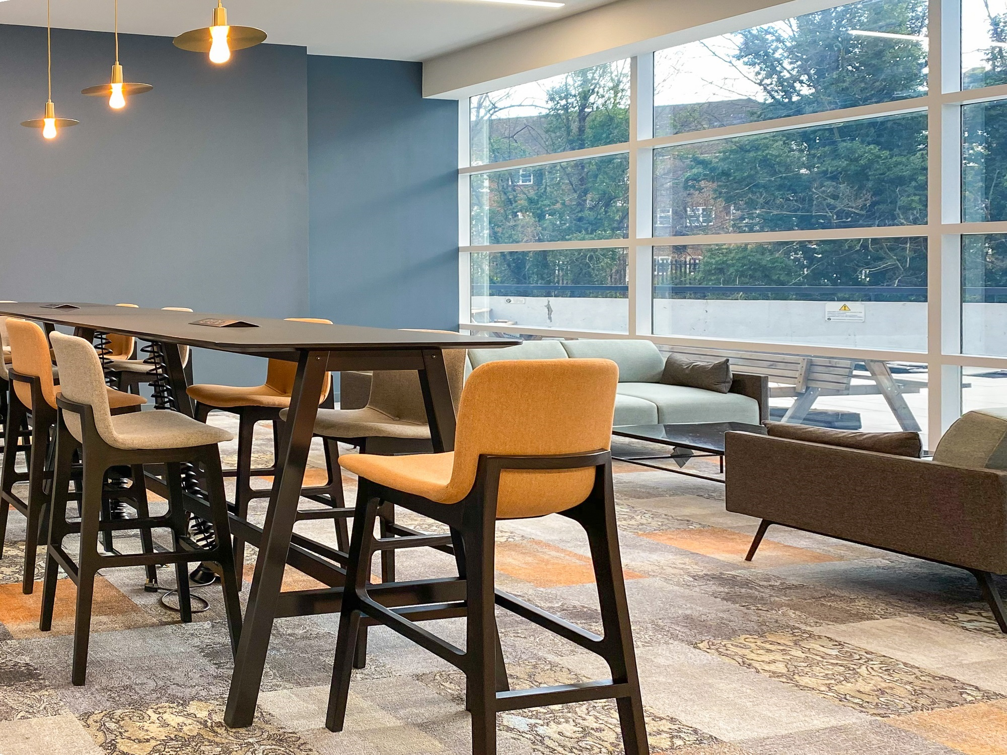armless stools round a brown table