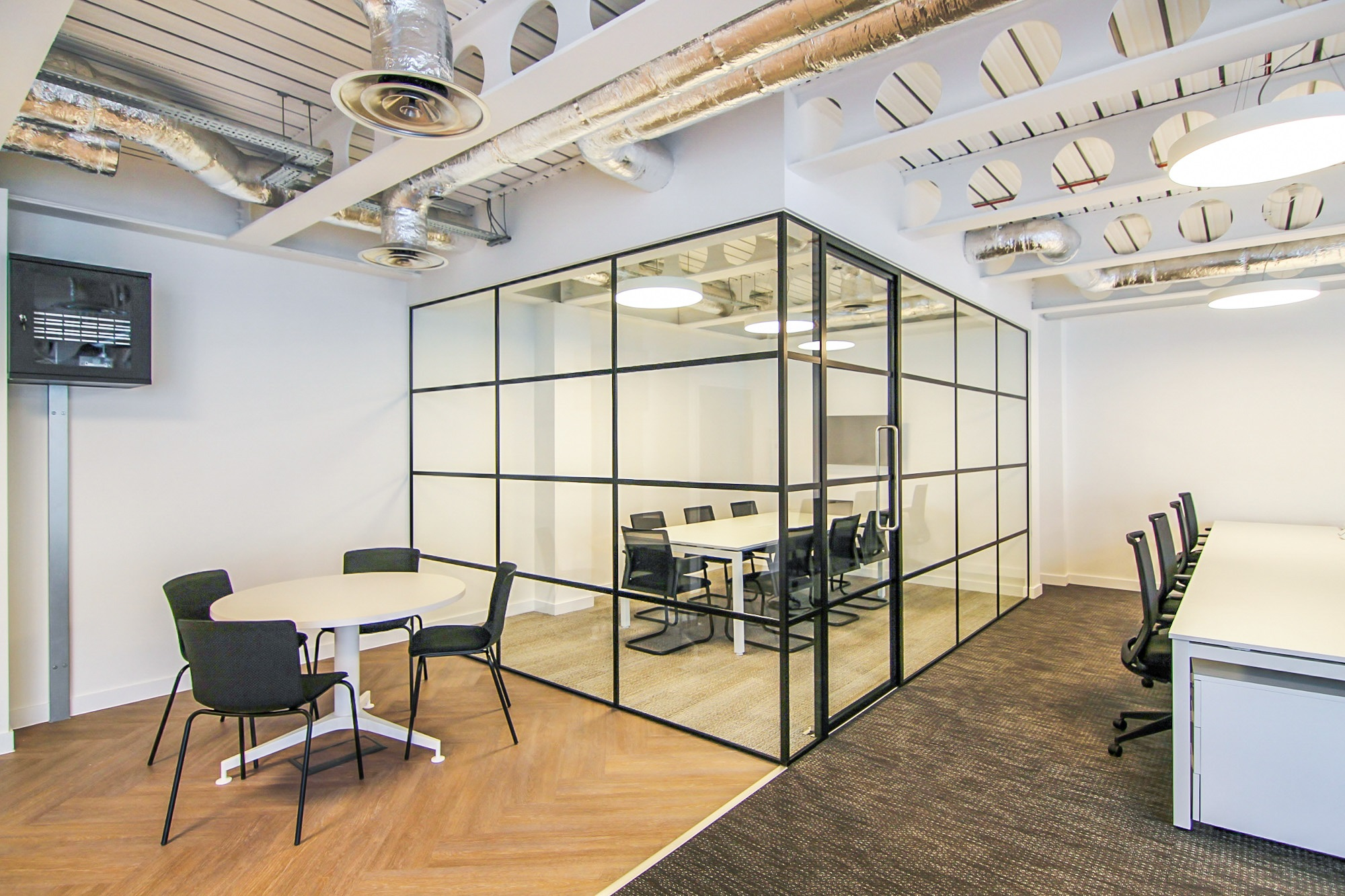 board room table within a glass cubicle