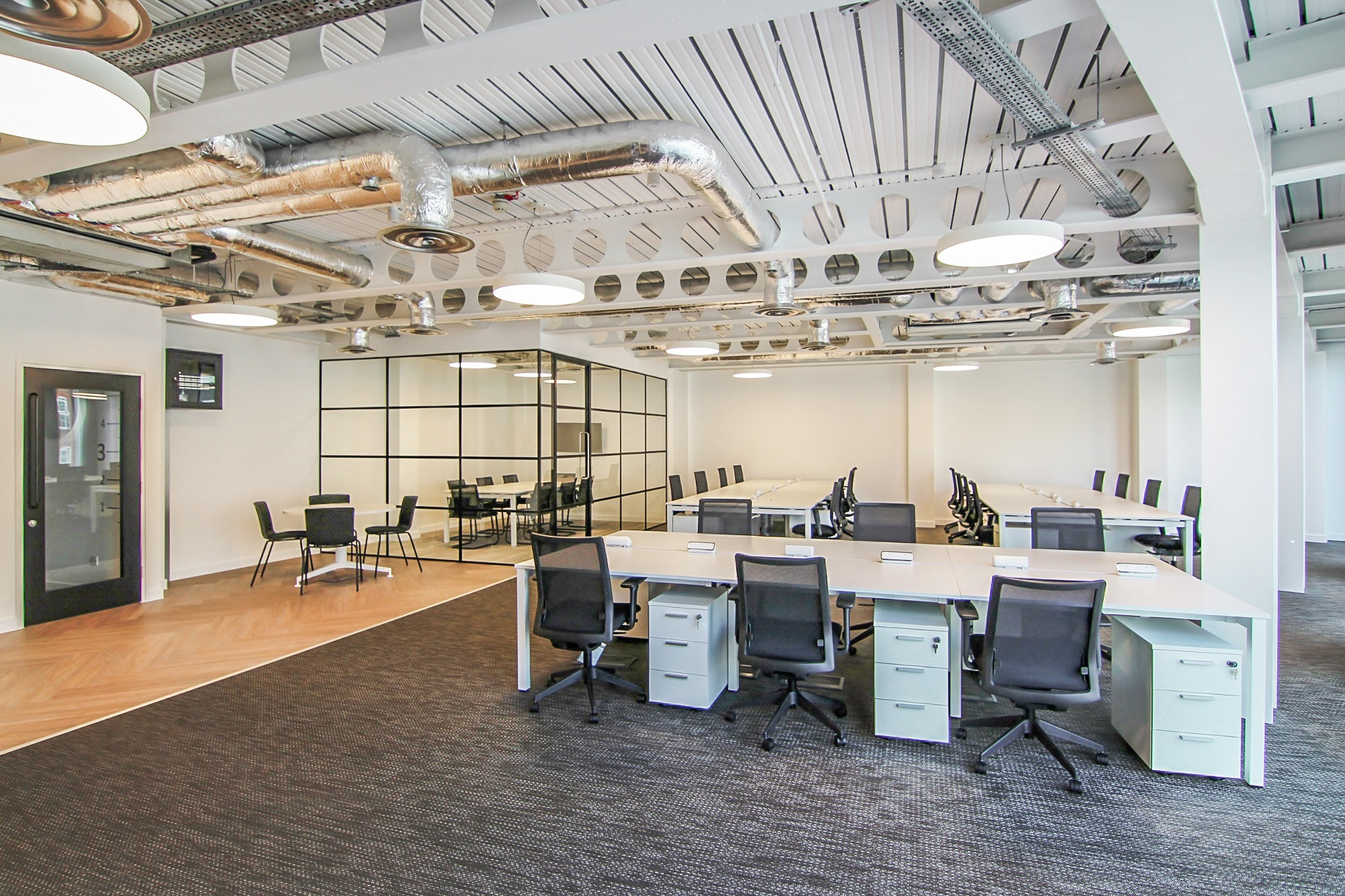 white exposed office ceiling with silver ducts
