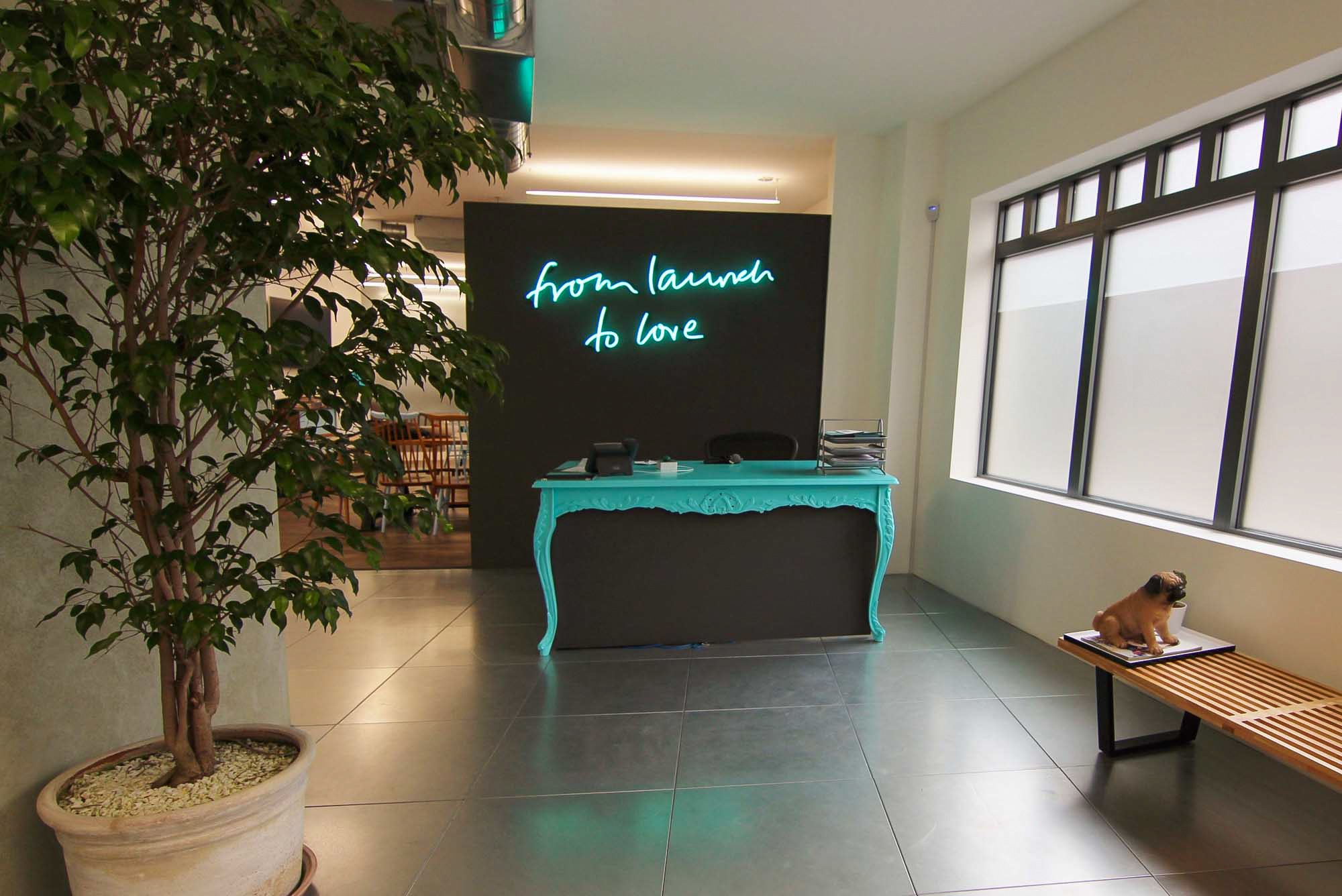 neon light behind a reception area