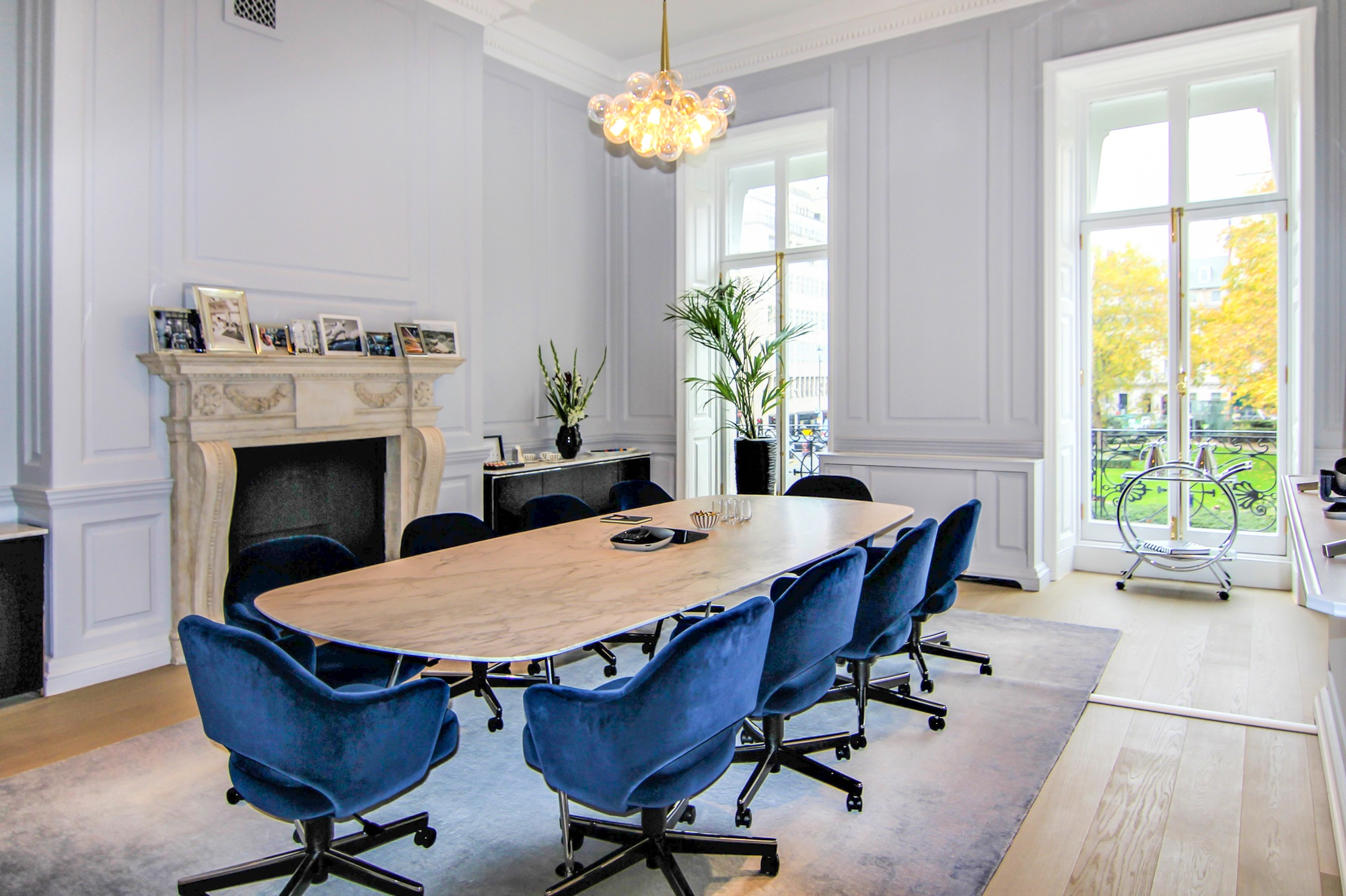 blue egg chairs around a gloss desk