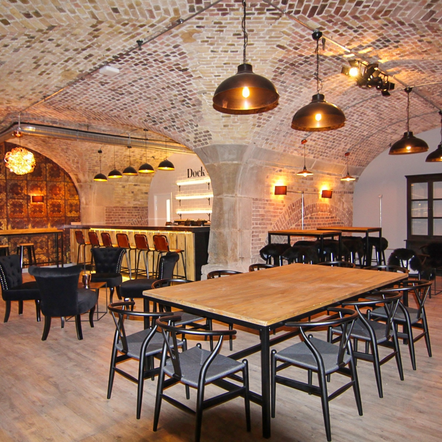 exposed brick room with tables and chairs