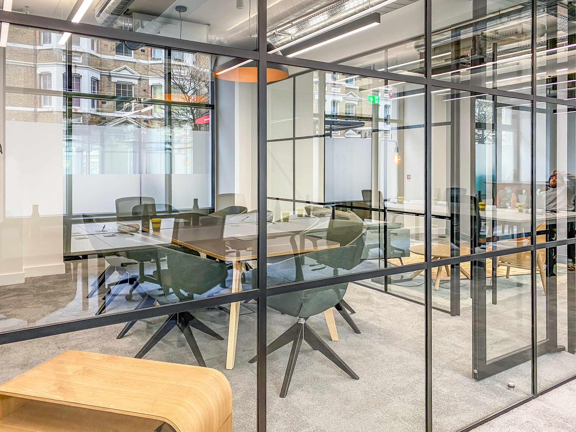 board room within a glass cubicle