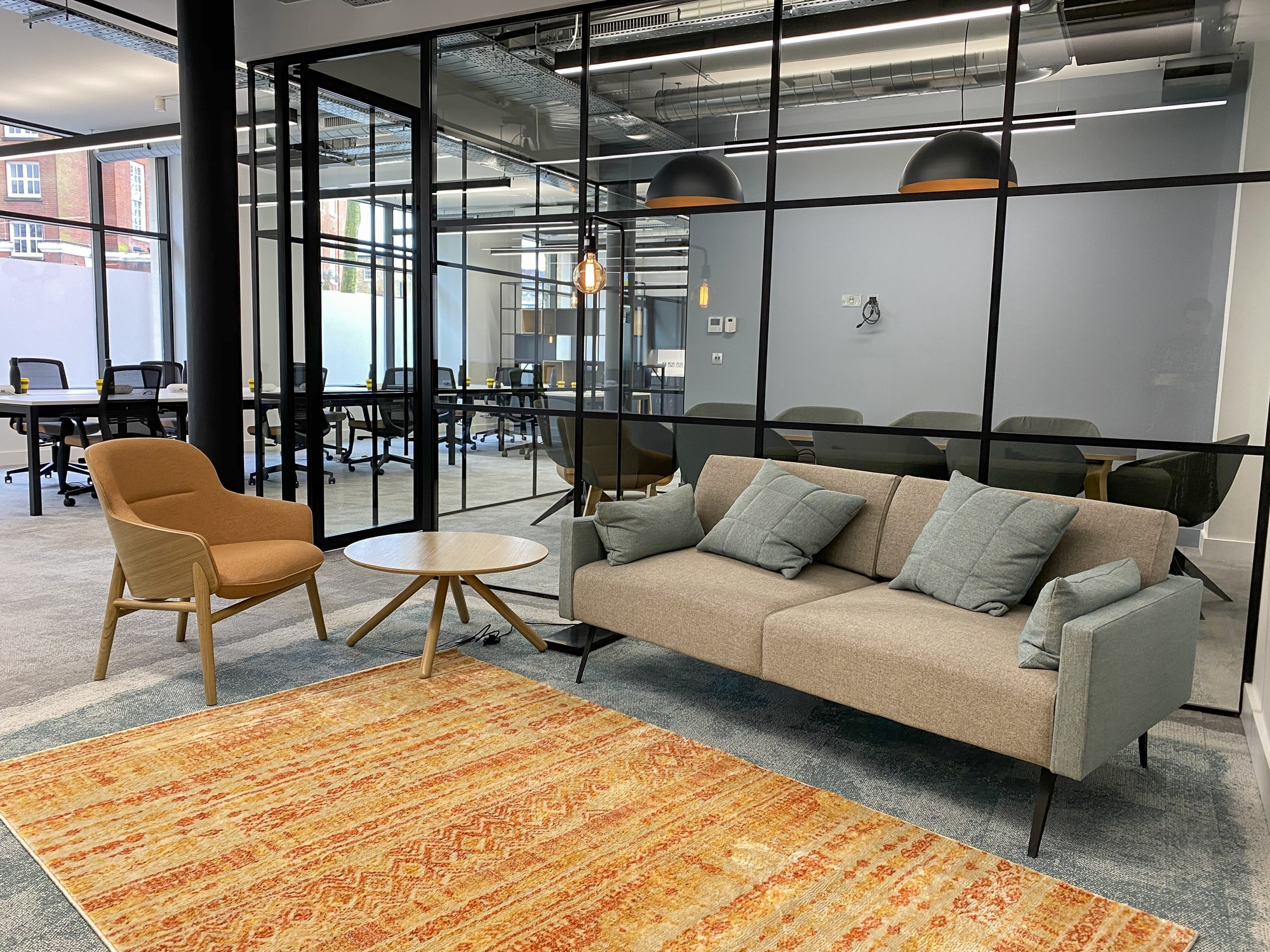 open plan office with boardroom and sofa