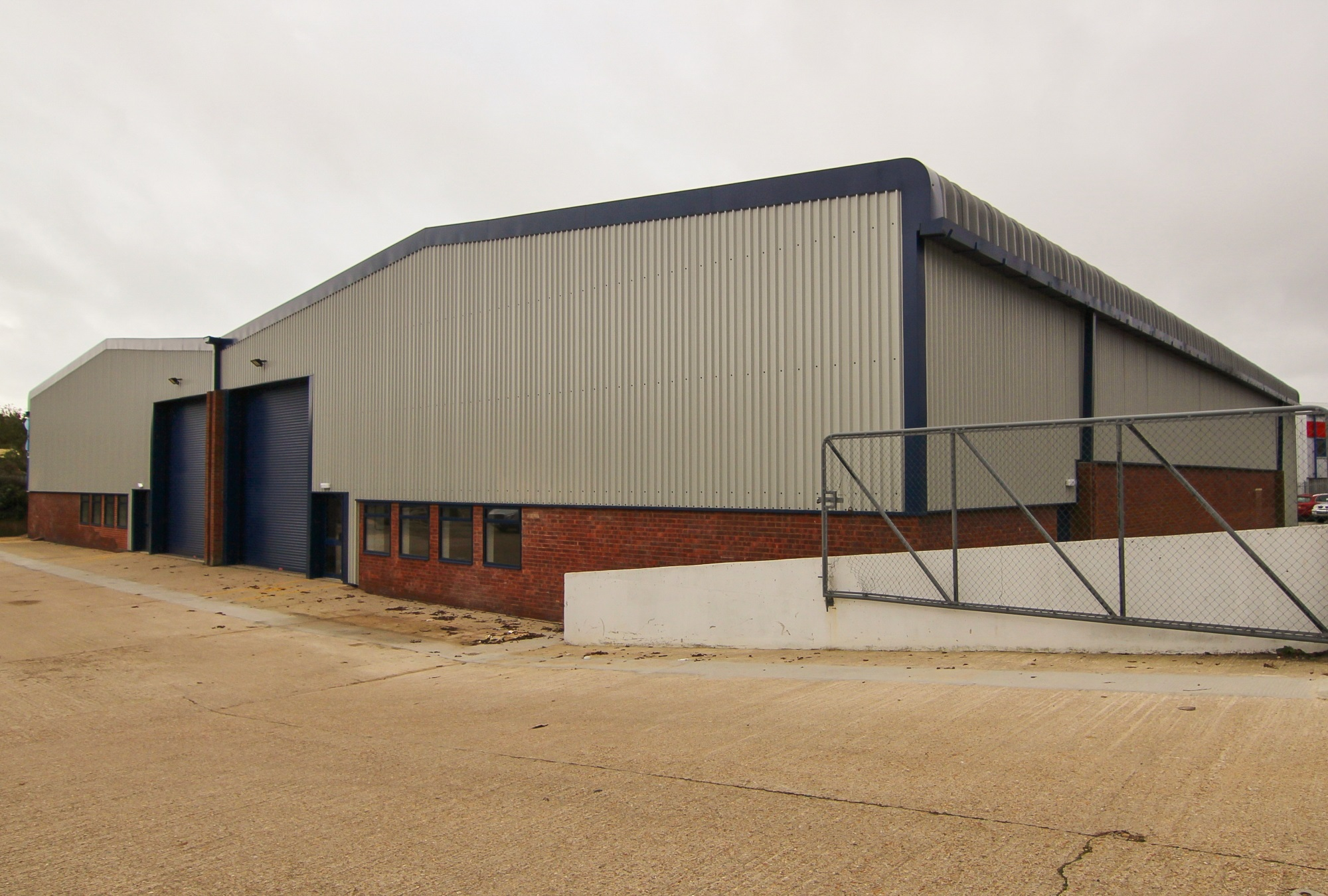 a ramp leading down towards the industrial building unit