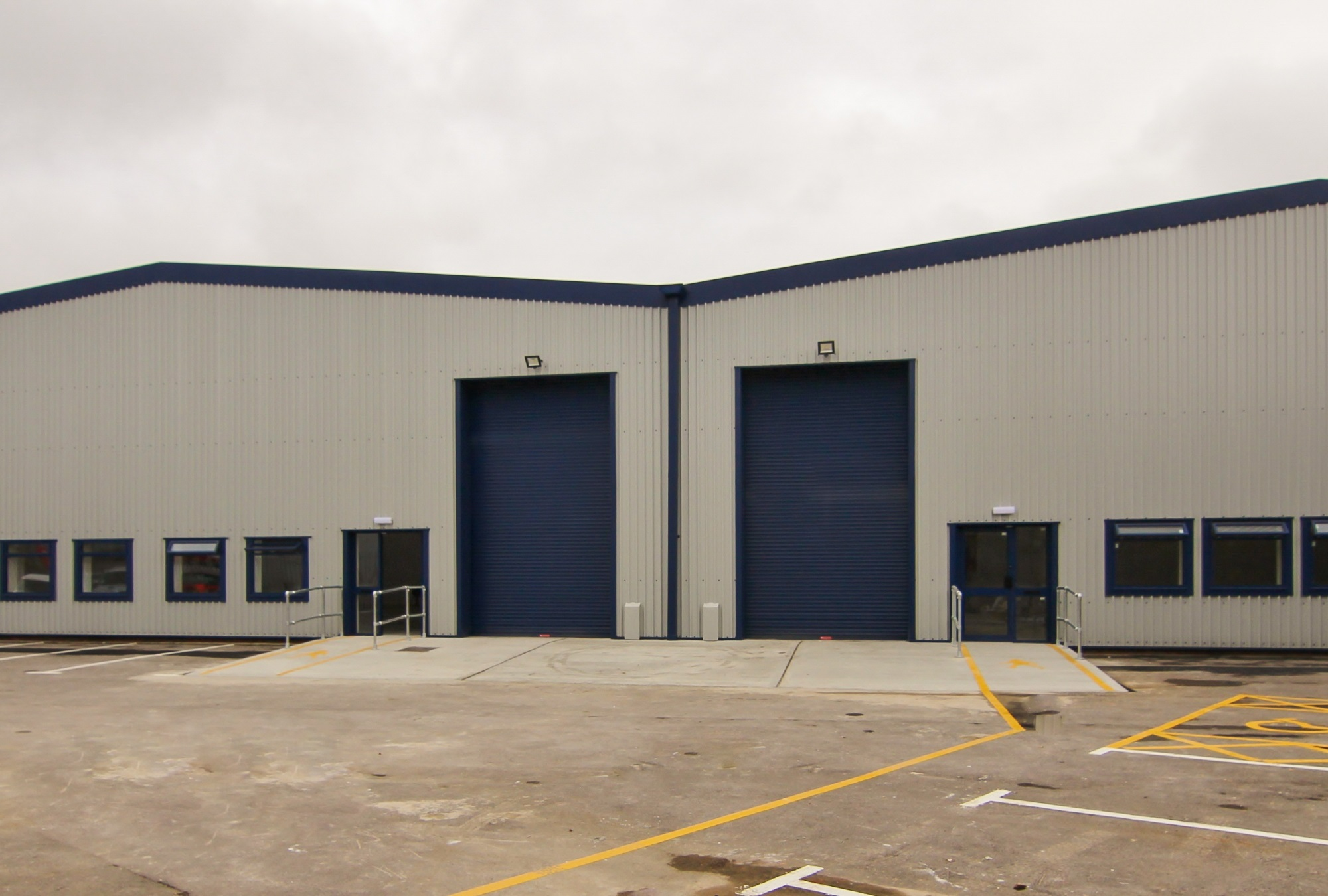 warehouse with two large blue doors