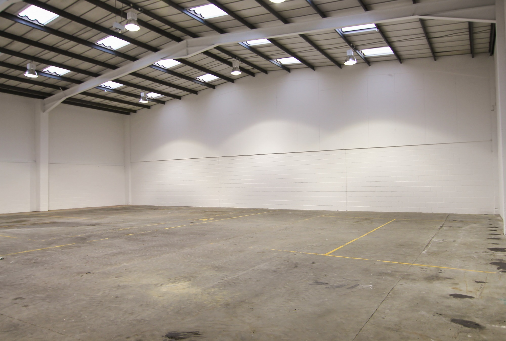 empty warehouse with white brick wall