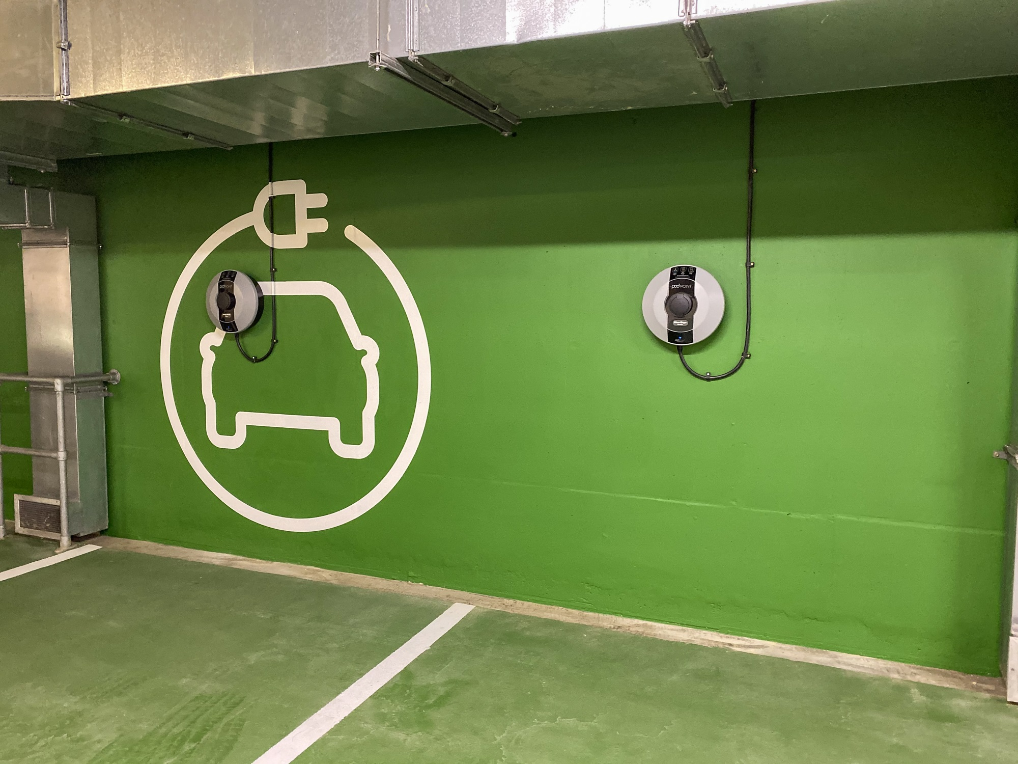 car parking space with green wall