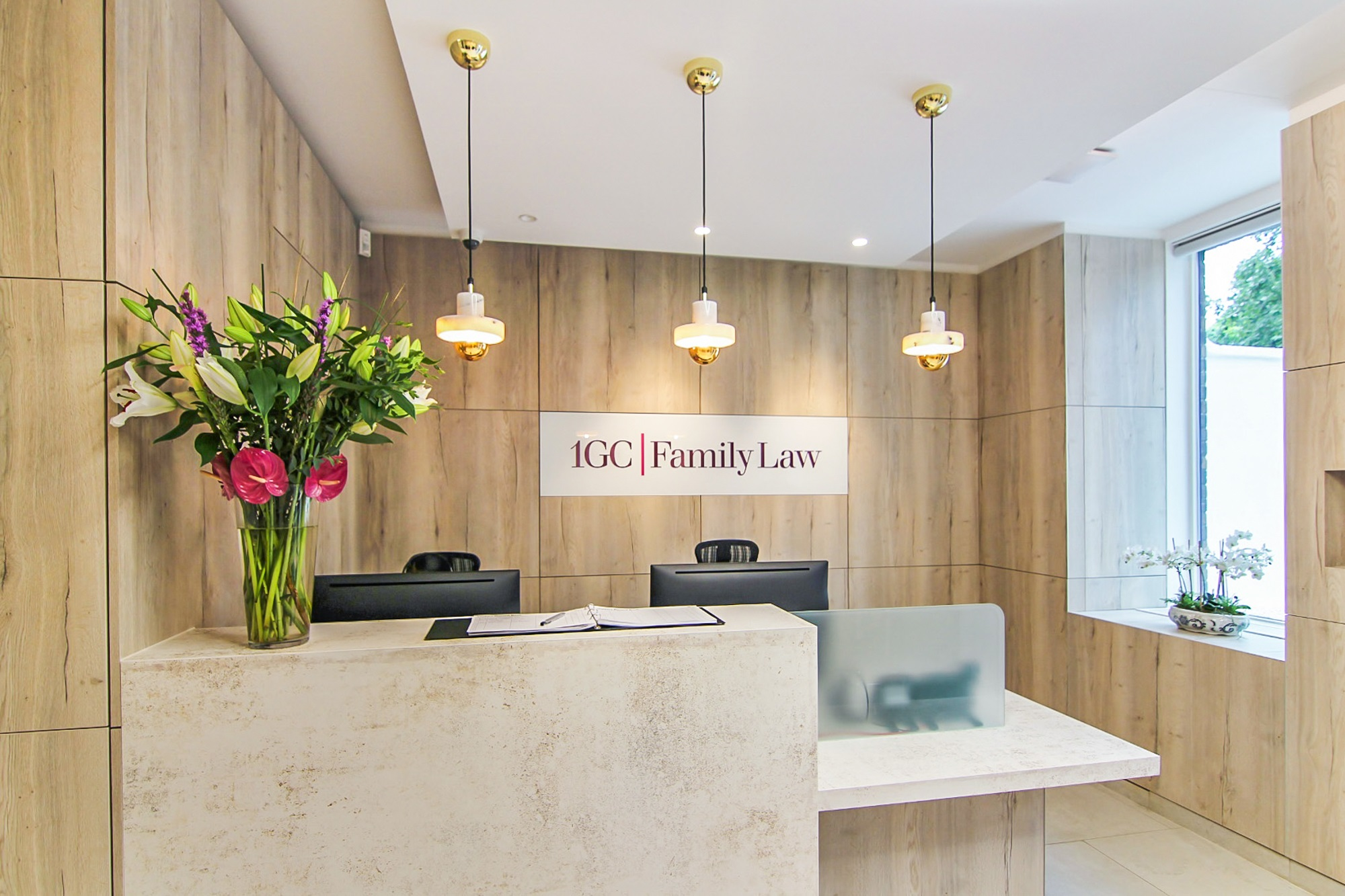 reception area with hanging lights and flower vase