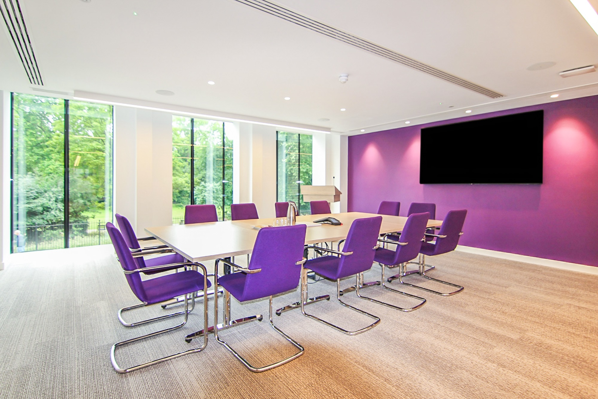 office board room with purple chairs and wall