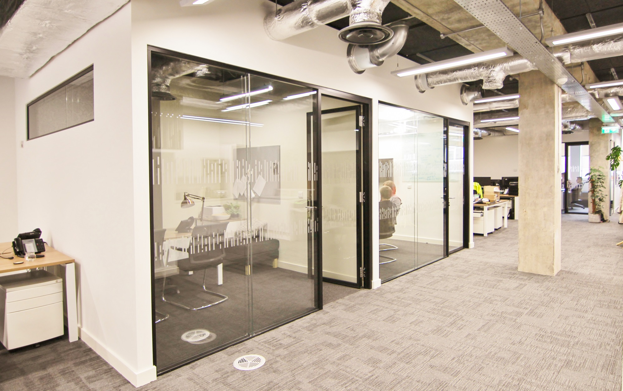 office cubicle with glass walls