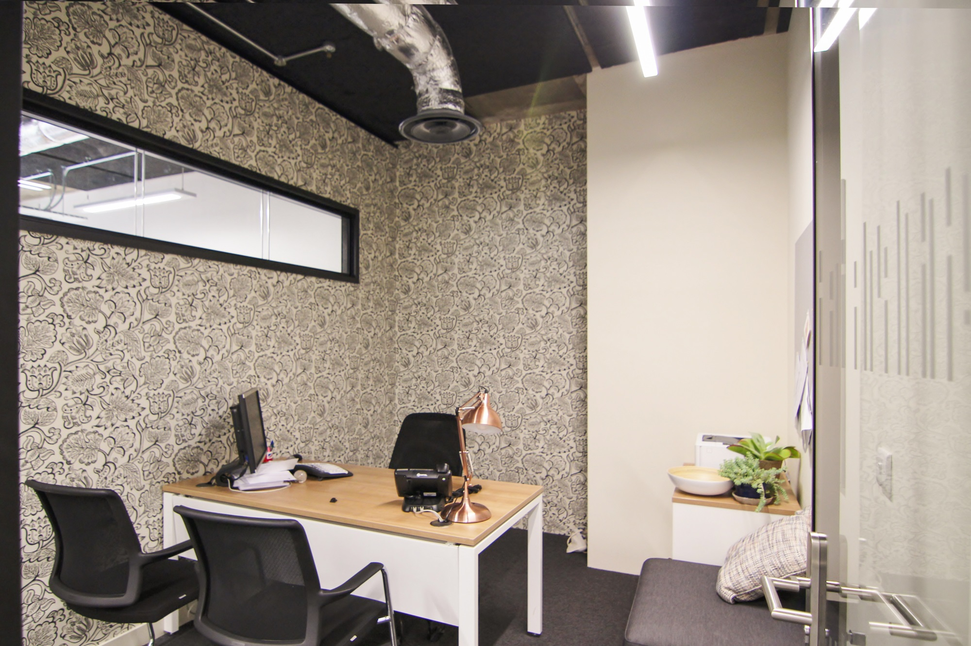 office room with flower wallpaper