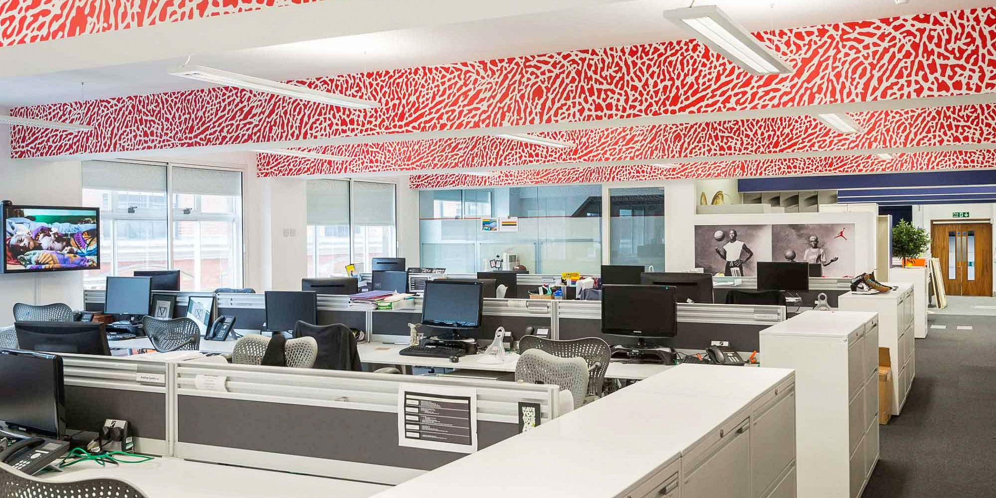 office with red vibrant ceiling design