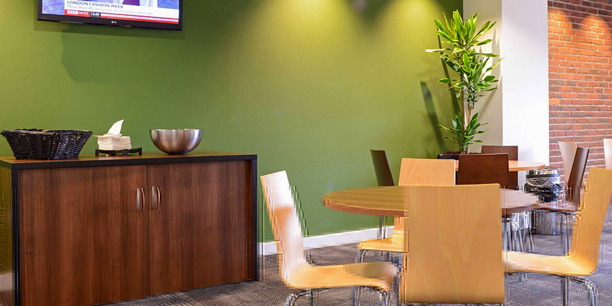 communal seating area with green wall