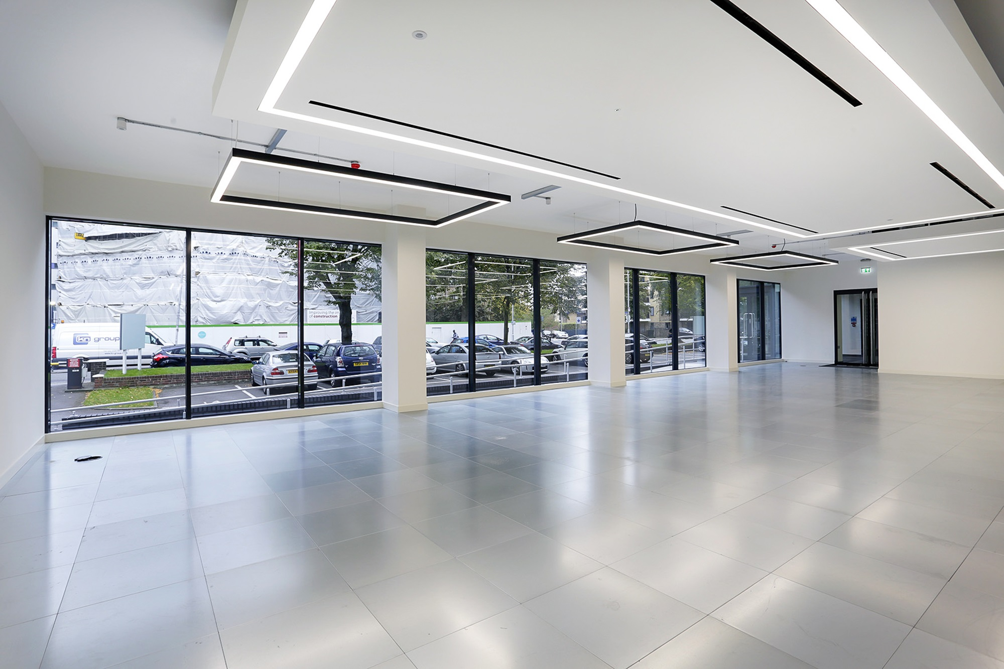 refurbished empty office space with white ceiling