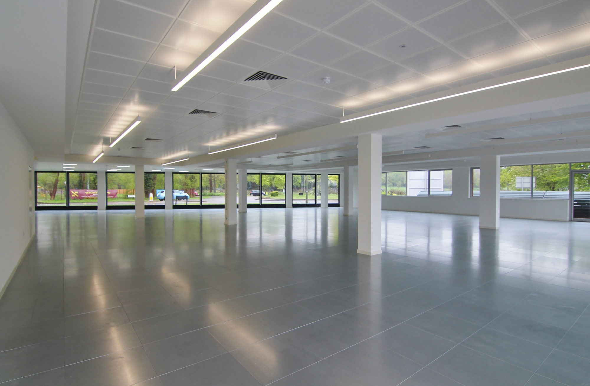 refurbished empty office space with large glass windows