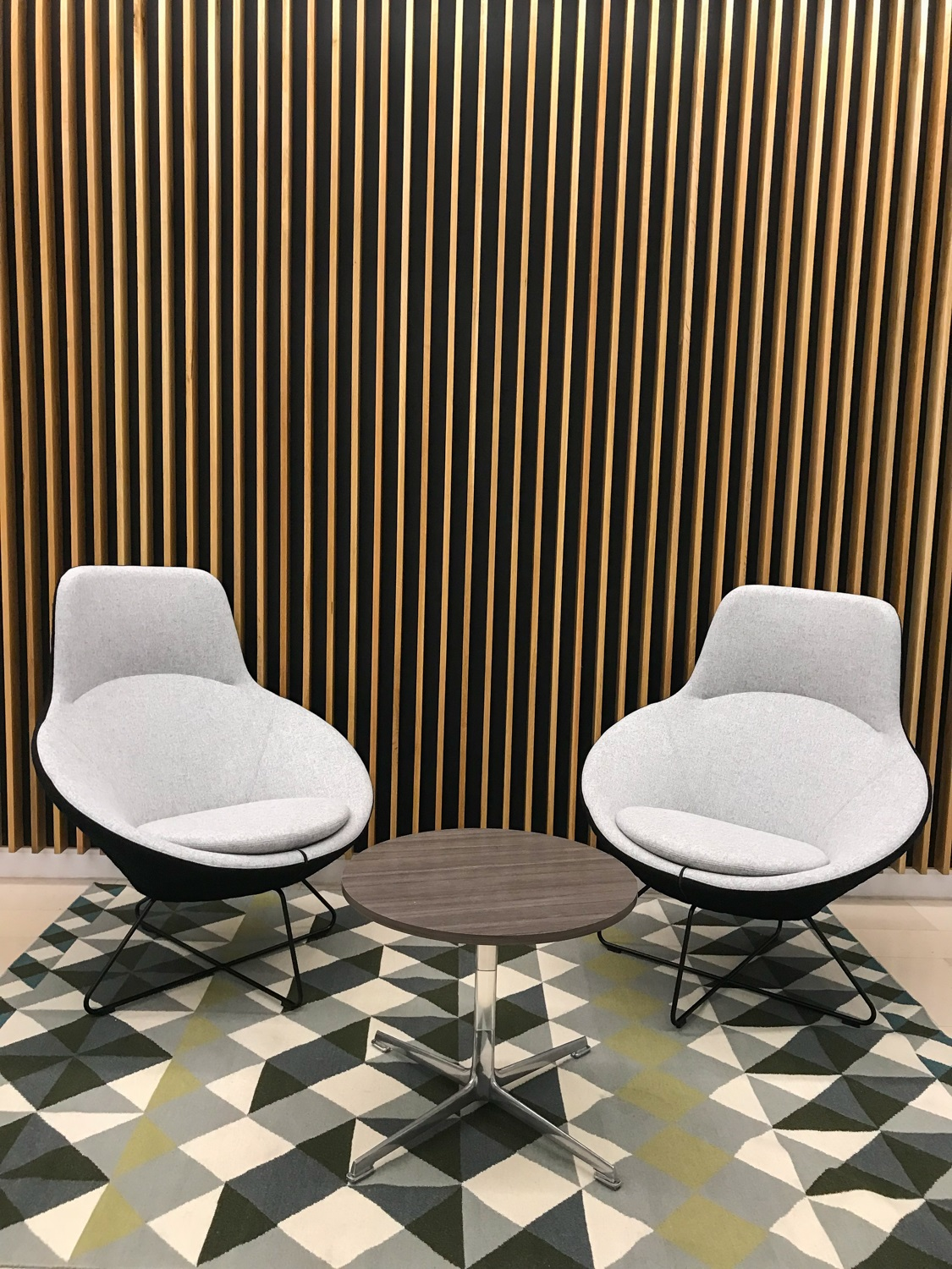 two modern chairs around a circular coffee table