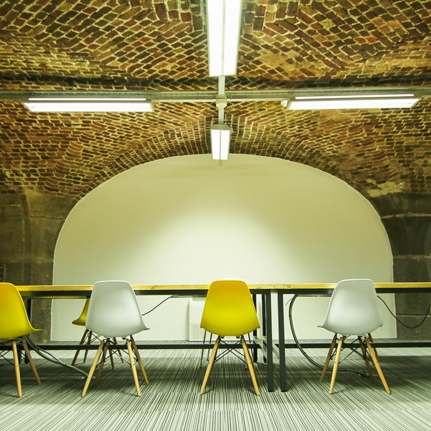 internal office with exposed brick ceiling