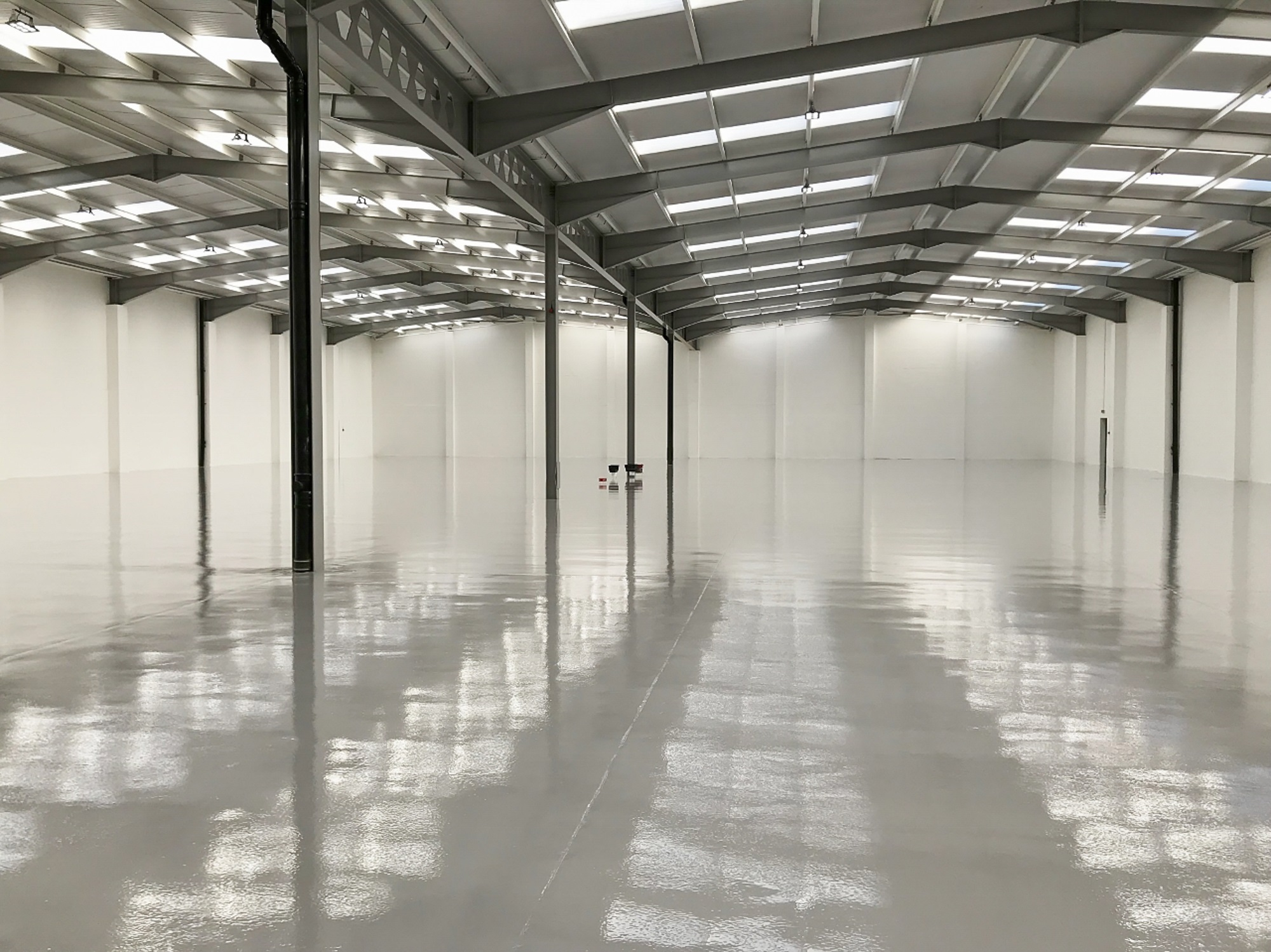 warehouse unit with a gloss white floor