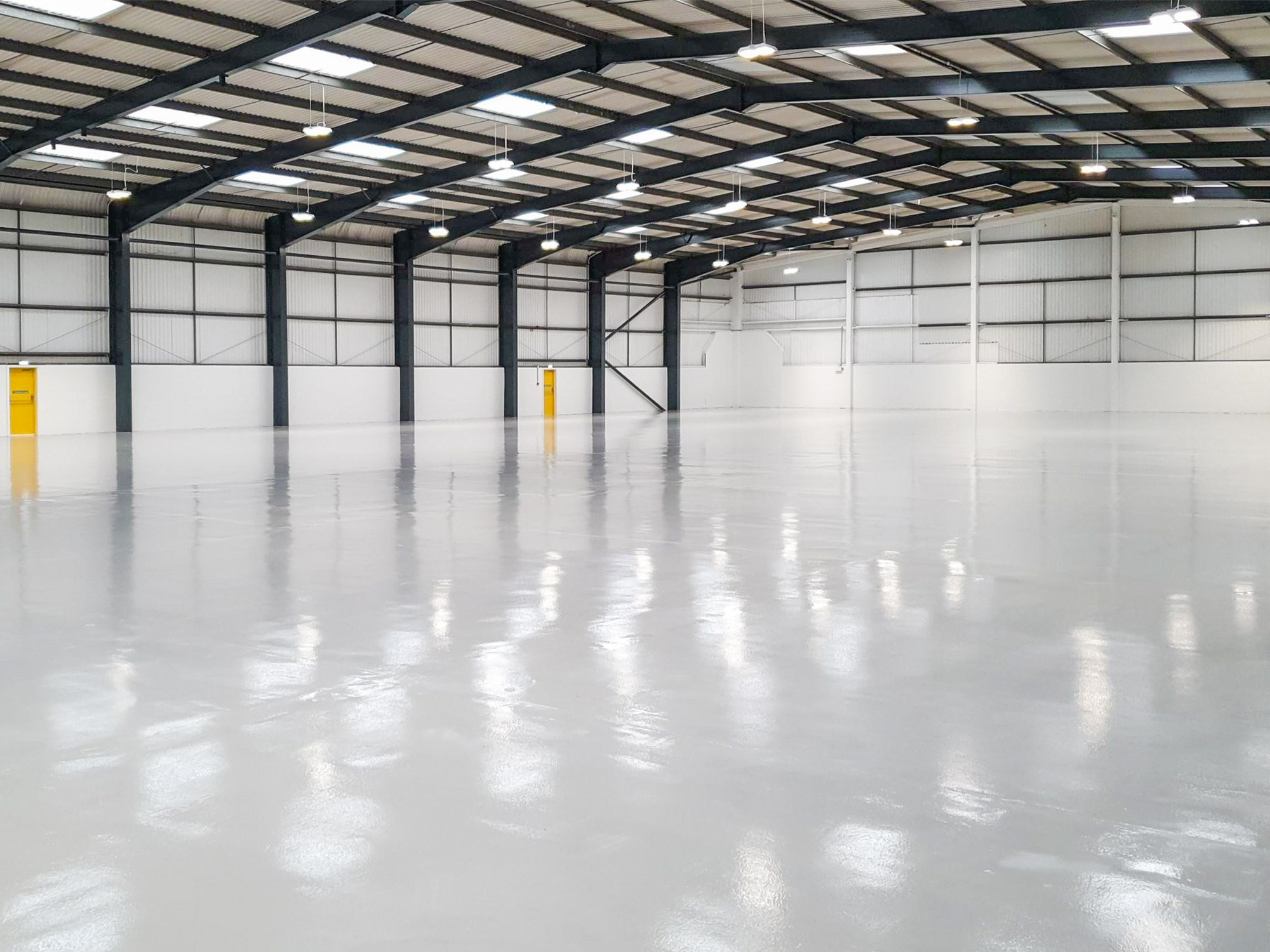 empty warehouse with a gloss white floor