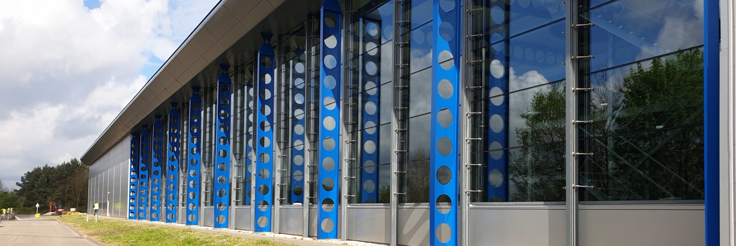 building with a blue exterior metal brace